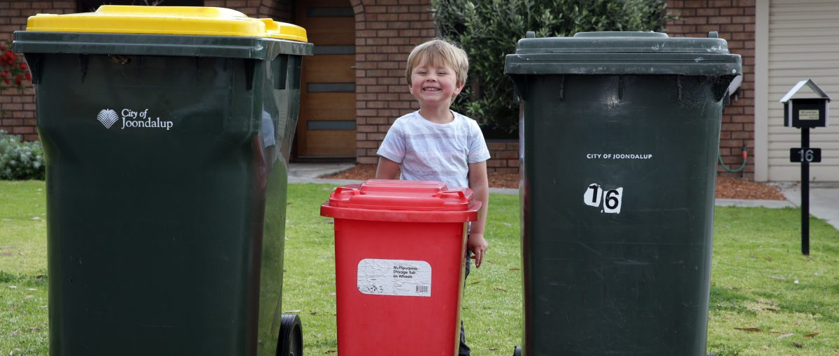 child with three bins
